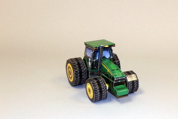 John Deere promotional packaging to unveil new tractor line.