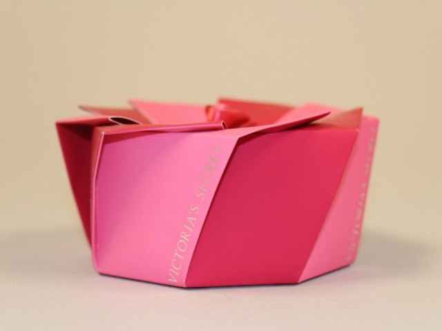 A custom origami-style box that shipped flat to retailers - stacked like coffee filters - for Victoria Secret.