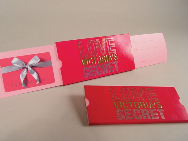 "Victoria's Secret chose our exclusive Extendo® as their new gift card holder. When you pull on the right hand-side, another panel, carrying the gift card, automatically extends out to the left, presenting the recipient with their gift. The ""To"" and ""From"" sentiment is added to the right-hand panel."